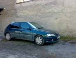 Peugeot 306 instalace protislunecni autofolie Llumar AT5